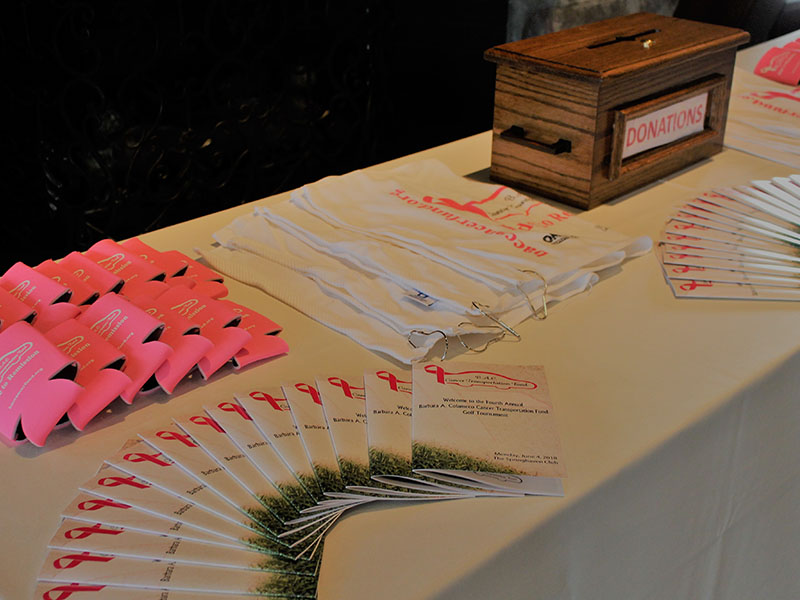 Table with booklets for fundraiser